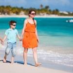 Family at Caribbean beach — Stock Photo #24461085