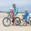 Father and kids riding bikes — Stock Photo