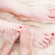 Feet on tropical sand — Stock Photo #24896015