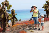 Father and daughter at scenic terrain on Galapagos South Plaza island — Stock Photo