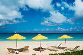 Chairs and umbrellas on a beautiful Caribbean beach — Stock Photo