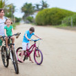 Stock Photo: Father and kids on bikes