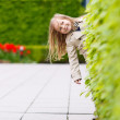 Adorable little girl outdoors - Stock Photo
