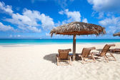 Chairs and umbrella on tropical beach — Stock fotografie