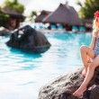 Stockfoto: Little girl near swimming pool