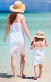 Mother and daughter walking on beach — Stock Photo