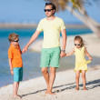 Father and kids on a beach — Stock Photo