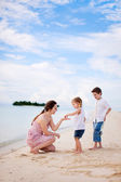 Mother and two kids on beach — Stock Photo