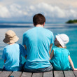 Father and kids enjoying ocean view — Stock Photo
