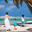 Stock Photo: Mother and kids on tropical island