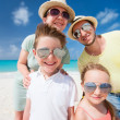 Stock Photo: Family on a tropical beach vacation