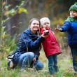 Family at autumn park — Stock Photo #30692099