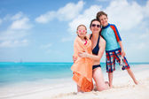 Mother and kids at beach — Stock Photo