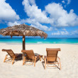 Chairs and umbrella on tropical beach — Stock Photo #31899731