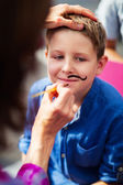 Cute boy with painted mustache — Stock Photo