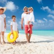 Family on a tropical beach vacation — Stock Photo #32365065