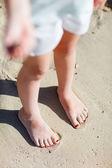 Feet on tropical sand — Stock Photo