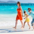 Family at Caribbean beach — Stock Photo