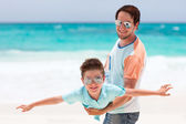 Father and son at beach — Stock Photo