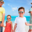 Family on a tropical beach vacation — Stock Photo #34271039