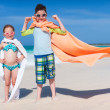 Superheros at a beach — Stock Photo