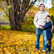 Father and son outdoors at autumn day — Stock Photo
