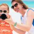 Stock Photo: Mother and daughter photographing
