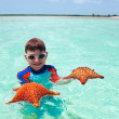 Little boy with a starfish — Stock Photo #35073095