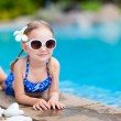 Little girl at swimming pool — Stock Photo #35368601