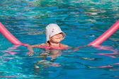 Little girl at swimming pool — Stock Photo