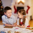 Kids baking Christmas cookies — Stock Photo #37006919