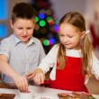Kids baking Christmas cookies — Stock Photo #37006923