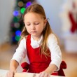 Girl baking Christmas cookies — Foto de Stock
