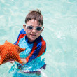 Little boy holding a giant starfish — Stock Photo #39581737