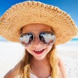 Adorable little girl at beach — Stock Photo