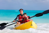 Father and son kayaking — Stock Photo