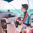 Boy drives catamaran — Stock Photo