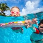 Kids in swimming pool — Stock Photo #39984465