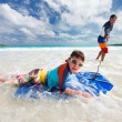Stock Photo: Father and son boogie boarding