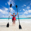 Stock Photo: Boy with kayak paddles