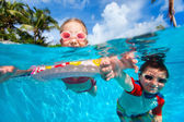 Kids in swimming pool — Stock Photo
