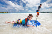 Father and son boogie boarding — Stock Photo