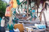 Kids exploring beach hut — Stock Photo