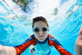 Boy swimming underwater — Stock Photo