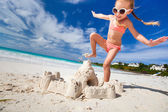 Little girl playing at beach — Stock Photo