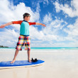 Boy practice surfing at beach — Stock Photo