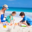 Stock Photo: Mother and kids playing at beach