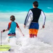 Father and son surfing — Stock Photo