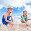 Stock Photo: Mother and daughter playing at beach