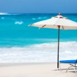 Chairs and umbrella on tropical beach — Stock Photo